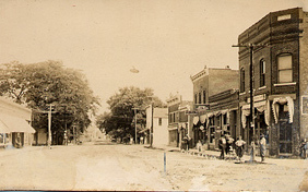 Early postcard view of Station Street in Chelsea, Iowa.