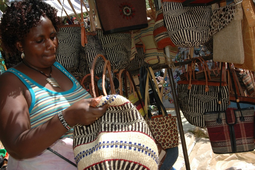 A woman wrapped in Kikoy (Kikoi) looks at a Kiondo basket. The two Kenyan indigenous items have been at the centre of controversy over their IP.