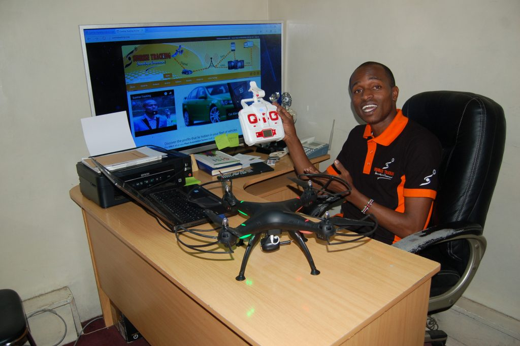 Young innovator Kelvin Macharia displays a multipurpose drone he is making. Photo by Fredrick Nzwili