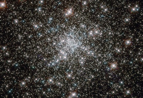 "NASA image release February 8, 2012 Looking like a hoard of gems fit for an emperor's collection, this deep sky object called NGC 6752 is in fact far more worthy of admiration. It is a globular cluster, and at over 10 billion years old is one the most ancient collections of stars known. It has been blazing for well over twice as long as our solar system has existed. NGC 6752 contains a high number of ""blue straggler'' stars, some of which are visible in this image. These stars display characteristics of stars younger than their neighbors, despite models suggesting that most of the stars within globular clusters should have formed at approximately the same time. Their origin is therefore something of a mystery. Studies of NGC 6752 may shed light on this situation. It appears that a very high number -- up to 38 percent -- of the stars within its core region are binary systems. Collisions between stars in this turbulent area could produce the blue stragglers that are so prevalent. Lying 13,000 light-years distant, NGC 6752 is far beyond our reach, yet the clarity of Hubble's images brings it tantalizingly close. Credit: ESA/Hubble & NASA"