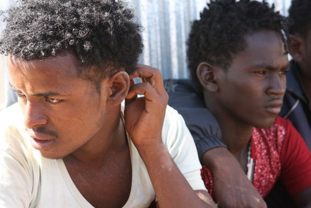 Eritrean teenagers and young men, aged from 16 to 20, waiting at the Badme entry point to be moved to the screening registration center. Credit: James Jeffrey/IPS