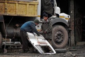 A 2009 study found that almost 250,000 children worked in auto repair stores, brick klins, as domestic labourers, and as carpet weavers and sozni embroiderers in Jammu and Kashmir. Laureates and global human rights activists have renewed their call for world leaders to double their efforts in protecting children from child labour and child trafficking during the COVID-19 pandemic and beyond. Credit: Umer Asif/IPS