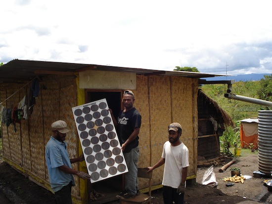 Communities in rural Papua New Guinea install their own cost effective and energy efficient solar panels / Credit: Catherine Wilson/IPS