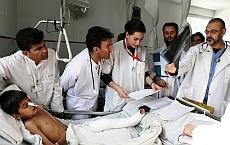 Italian  surgeon Marco Garatti (extreme right, holding x-ray).  /  Credit:Emergency