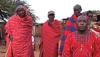 """A Maasai community explains their fights for their traditional land. / Credit:Image from """"The End of Poverty?"""""""
