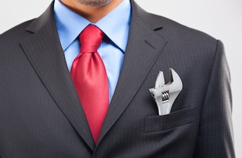 businessman wrench