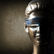 69894612 - face of lady justice in dark brown background