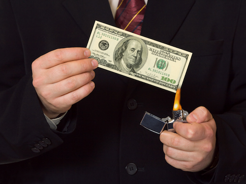https://depositphotos.com/4013287/stock-photo-man-burnning-the-money.html