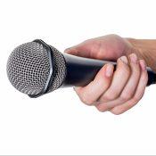 https://depositphotos.com/69798509/stock-photo-woman-holding-microphone.html