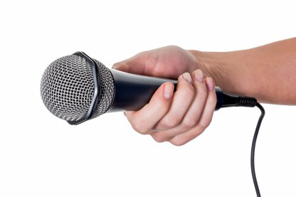 https://depositphotos.com/69798509/stock-photo-woman-holding-microphone.html