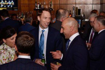 Richard Lloyd (facing center) shares a laugh with Matteo Sabattini of Ericsson.