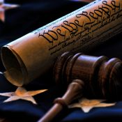 https://depositphotos.com/38780871/stock-photo-gavel-with-constitution-and-flag.html