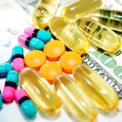 https://depositphotos.com/41440525/stock-photo-pills-on-money.html