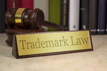 https://depositphotos.com/235666518/stock-photo-golden-sign-gavel-law-books.html