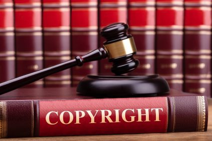 copyright law - https://depositphotos.com/211210396/stock-photo-close-wooden-judge-gavel-copyright.html