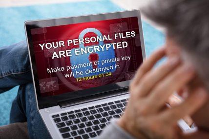 Ransomware - https://depositphotos.com/186938708/stock-photo-close-person-looking-laptop-screen.html