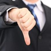Thumbs down businessman
