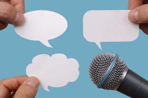 https://depositphotos.com/41785253/stock-photo-blank-speech-bubbles-with-microphone.html