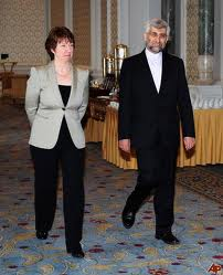 Iran's Chief Nuclear negotiator Saeed Jalili, right, and European Union Foreign Policy Chief Catherine Ashton arrive for talks between Iran and world powers on Iran's nuclear program at the historical Ciragan Palace in Istanbul, Turkey, Friday, Jan. 21, 2011.
