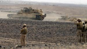 """Soldiers watch tanks advancing as they take part in joint Jordan-US maneuvers during the """"Eager Lion"""" military exercises in Mudawwara, near the border with Saudi Arabia, some 280 kilometres south of the Jordanian capital, Amman, on May 18, 2015. The annual """"Eager Lion"""" exercises includes the participation of 10,000 troops from at least 18 countries, and incorporates scenarios including disaster relief and air defense. AFP PHOTO / KHALIL MAZRAAWI        (Photo credit should read KHALIL MAZRAAWI/AFP/Getty Images)"""