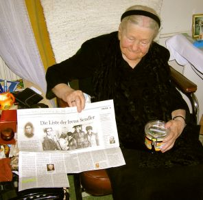 Irena holding newspaper article.