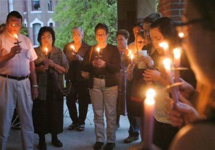 Members of the Bourbon County community have a candlelight service for Irena, this is the county where 'Life in a Jar' started.