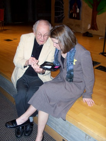 Ed Wiater, a World War II Vet, who is also a reporter, interviews a cast member at Canisius College in Buffalo, New York.