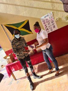 Bounty Killer donates Tablets to Seaview Gardens Primary