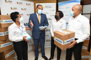 Health Minister Dr. Christopher Tufton thanks Massy for $4M donation towards Covid fight
