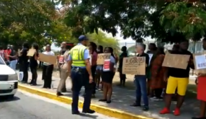 Students and staff protest at Edna Manley College in show of support for suspended principal