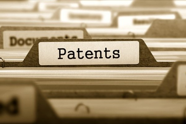 """The words """"Patent Application"""" written on a board by hand."""