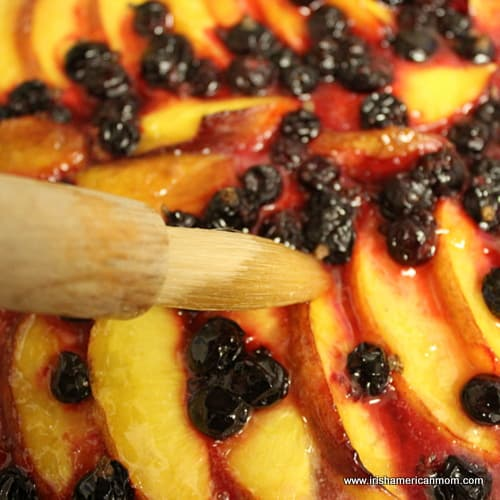 Glazing the fruit on a galette