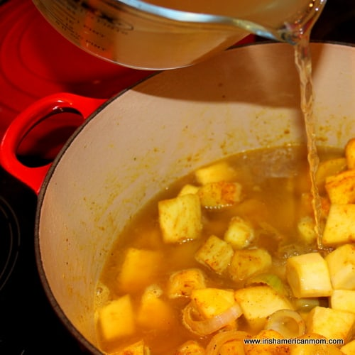 Adding broth to parsnip soup