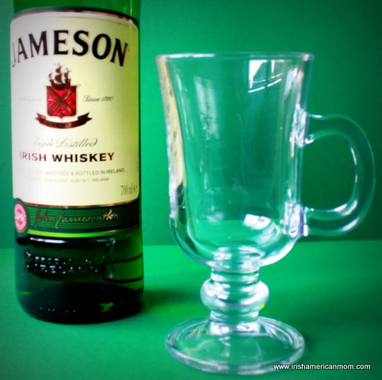 A glass with a handle for making hot whiskey