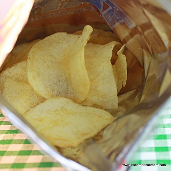 Open bag of Tayto cheese and onion crisps