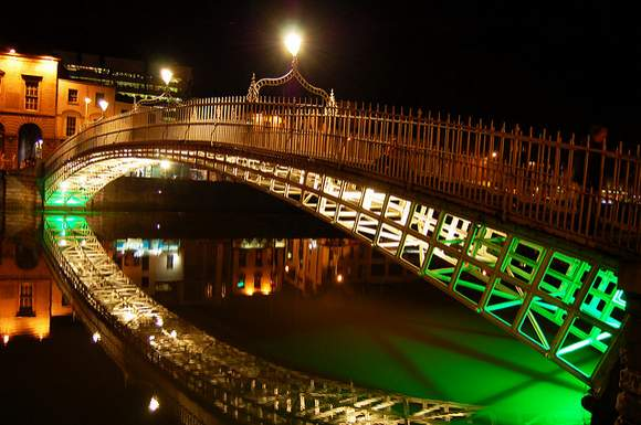 Green lights shining on the Ha'penny Bridge in Dublin