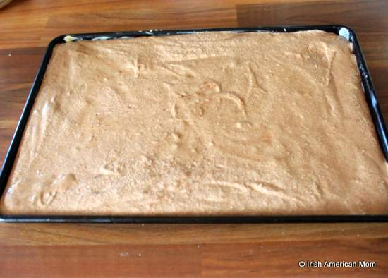 Roulade batter in a baking tray before cooking