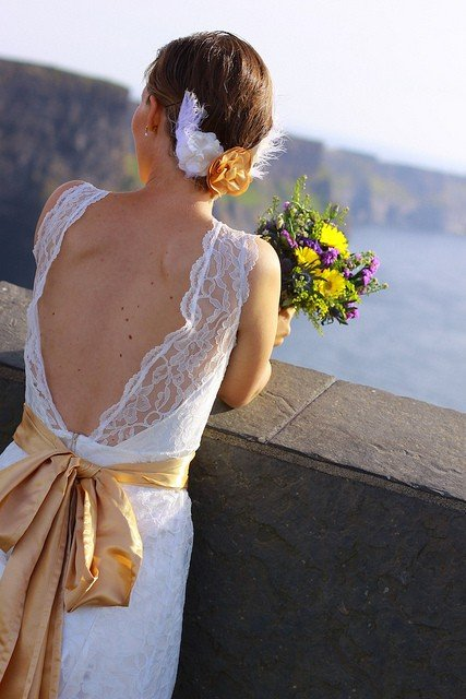 Irish wedding - the bride looks out over the Cliffs of Moher