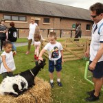 Children with some of the animals from the petting farm.