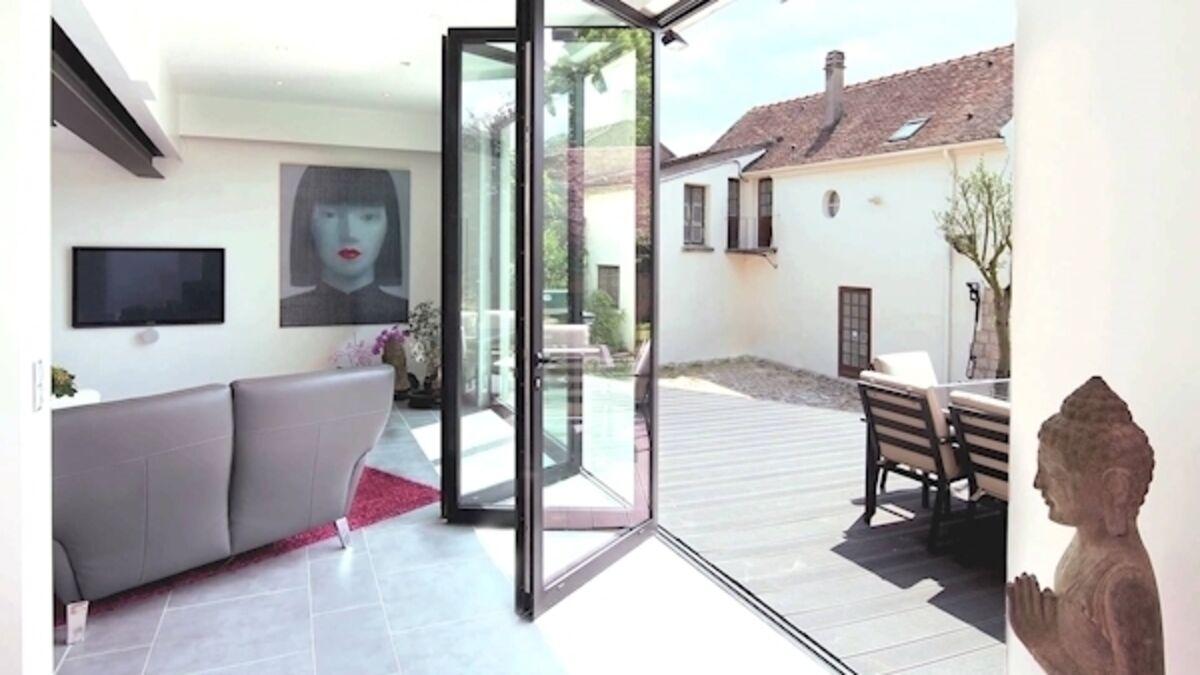 patio doors swing wide open to usher