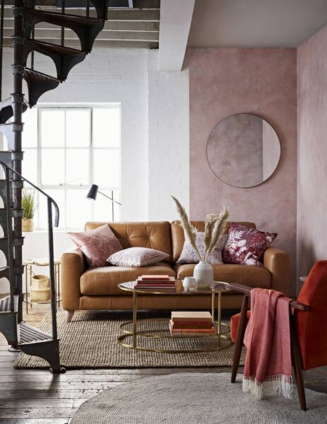 The Henley sofa in tan leather from M&S combines the practicality of leather upholstery with narrow arms and elevated on legs which contribute to a feeling of space (€1,899).