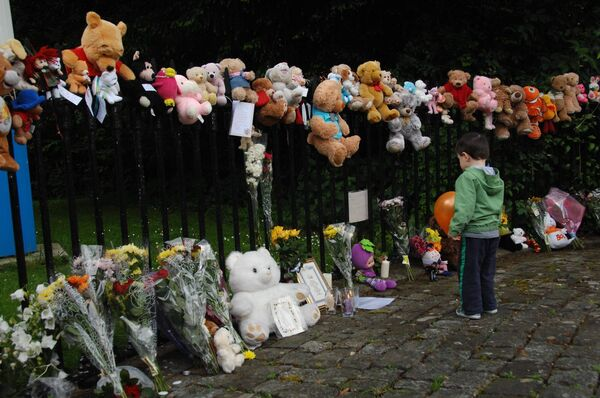 Children's teddies and flowers outside the gates of former mother and baby home Bessborough. Picture: Provision