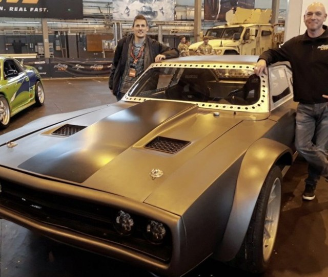 David Roy Left With Fast Furious Live Stunt Team Leader Chris Burns And The Ice Charger From The Fate Of The Furious