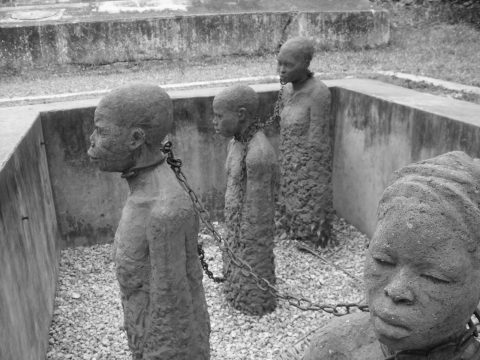 Monument depicting chained slaves in a pit, located in Zanzibar