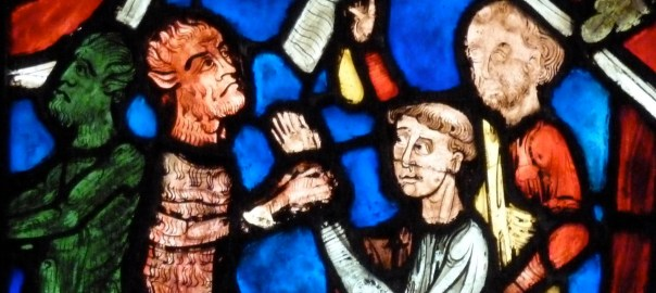 Stained glass depicting monks battling demons