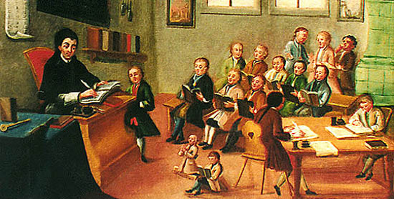 An 18th century school interior. Rows of boys sit, each with a book. To the left the teacher sits at a desk correcting the work on one boy. To the right, two others are writing. Two small children are seated on the ground.