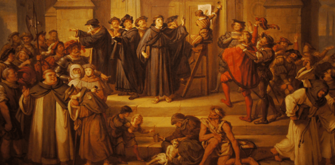 Luther stands in front of the church doors as his theses are nailed to it. A watching crowd has mixed reactions: friars leave angrily, one well-dressed man cheers, most look on in curiosity.
