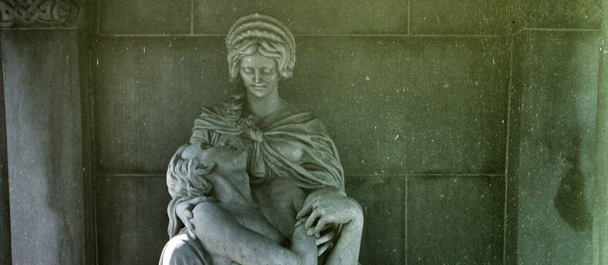 Sculpture of a woman cradling the figure of a Celtic warrior