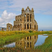 Ruins of Whitby Abbey, and its reflection in a pond.