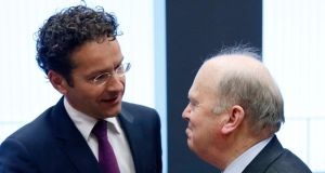 "Dutch finance minister Jeroen Dijsselbloem (left), chairing yesterday's meeting, said payments may be broken up if creditors deemed it ""necessary"" and ""helpful"". Photograph: Reuters/Francois Lenoir"